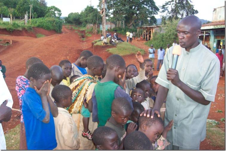 praying with some children
