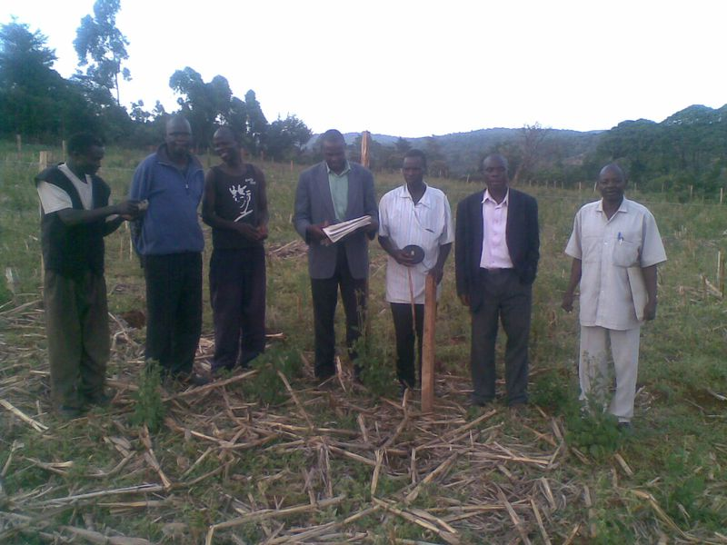 Pastor Titus and his team on the Land just bought for the Church